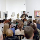 guy playing the guitar to an audience