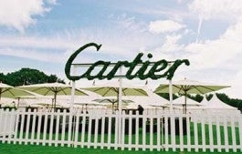 Cartier logo and white fence at Cartier International Polo