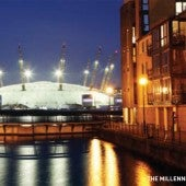Orange lights reflecting on Thames river on front of Millennium Dome