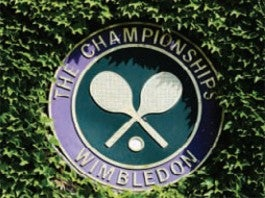 Wimbledon Tennis logo on hedge amongst leaves