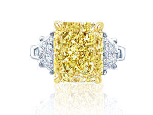Gorgeous fancy yellow diamond ring featuring a magnificent 6.26ct, GIA certified fancy yellow radiant diamond center, accented by emerald diamonds and edged with micro-pavé and additional fancy yellow diamonds. Handcrafted in platinum and 18K gold.