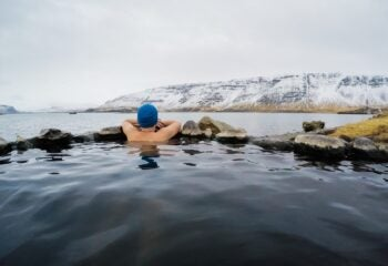 Swimmer looking out at Icelandic mountains