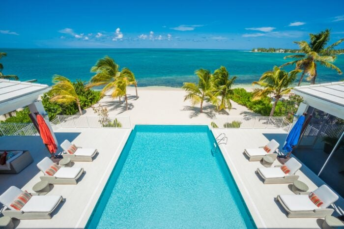 View of pool and beach in Cayman Islands