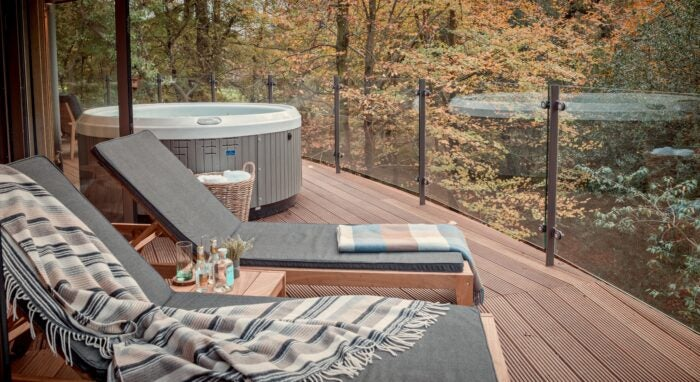 Chewton Glenn Uk Spa Hotel treehouse suite outdoor terrace seating