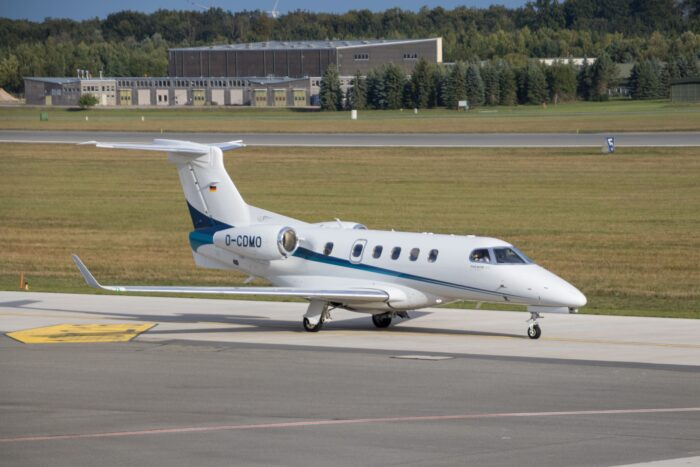 embraer phenom 100 private jet on runway