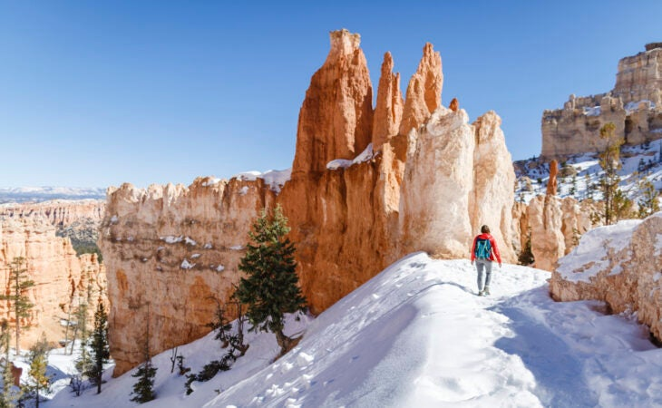 Lone hiker at Snow covered Bryce Canyon