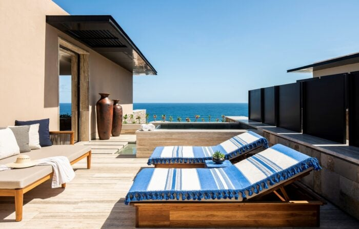 A terrace with two loungers at the Villa in Zadun