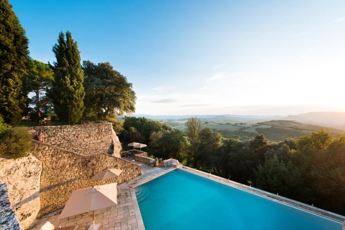 The infinity pool at Borgo Pignano overlooking the hills