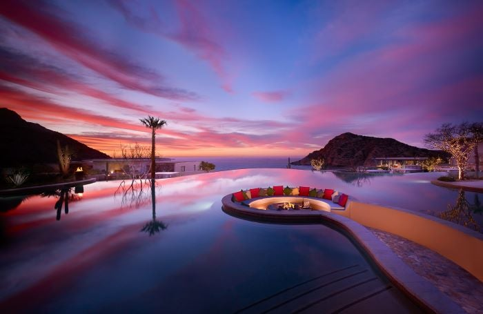 Firepit at Montage Los Cabos with sunset in background