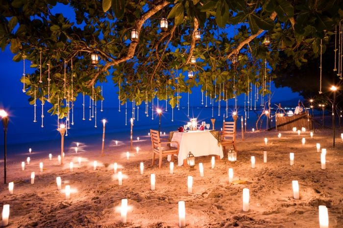 Private dining on beach at Sarojin