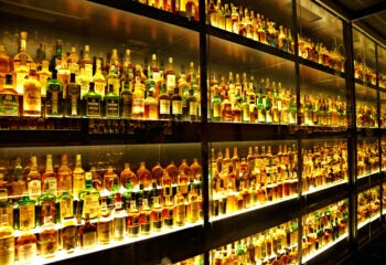 Collection of 100's of Scotch bottles in Cabinet