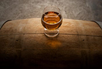 Dram of whisky atop a barrel