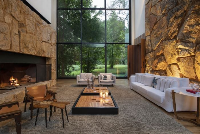 The lounge with sofa and fireplace at the Six Senses Boutanique