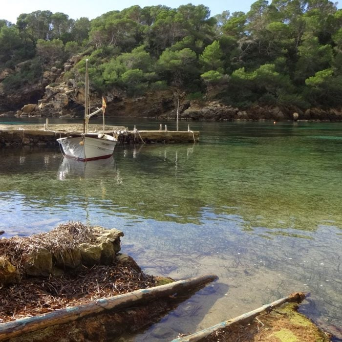 secluded bay with boat in ibiza