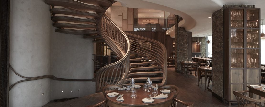 hide restaurant table and spiral staircase