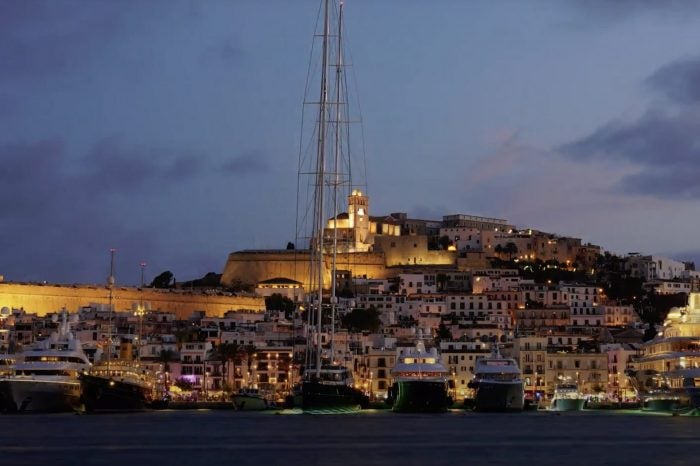 view of ibiza old town from boat at night