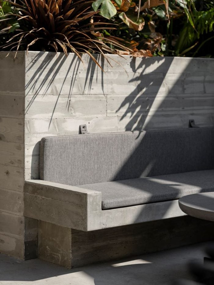 Grey seating and concrete floors