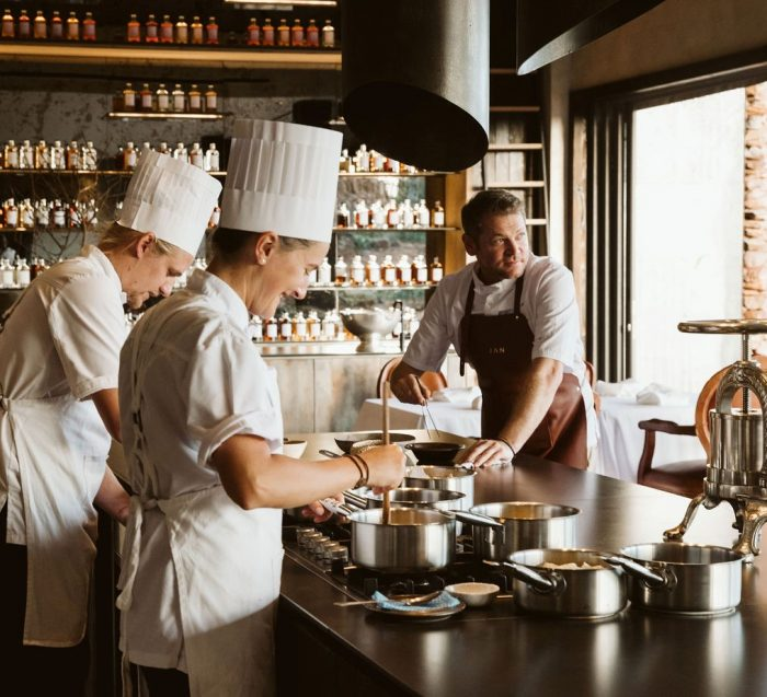 Chefs cooking in open kitchen