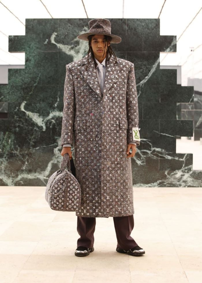 Man in LV coat with bag