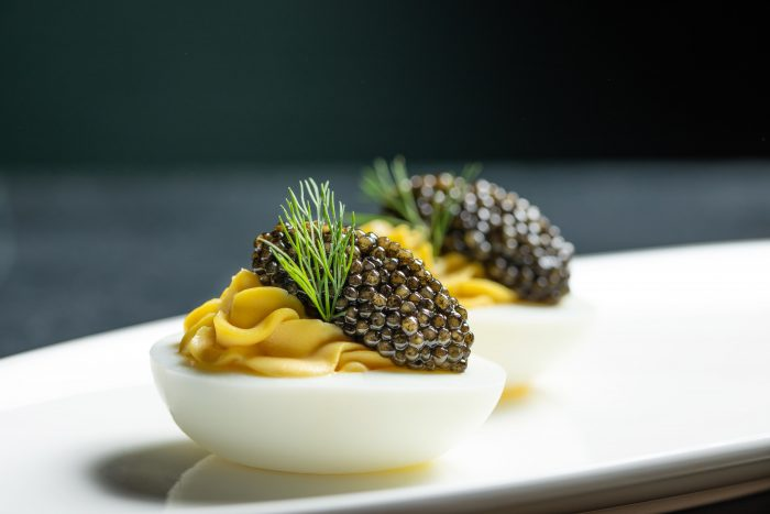 caviar served on deviled eggs at thomas keller pop up champagne and caviar lounge