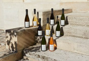 House of Telmont champagne bottles on a step