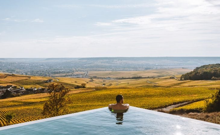 royal champagne hotel pool looking over vineyards