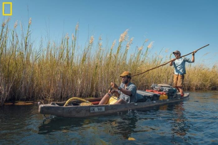National Geographic researchers canoe through the delta