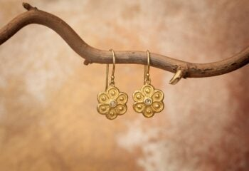 sophie theakston gold earrings in charity auction
