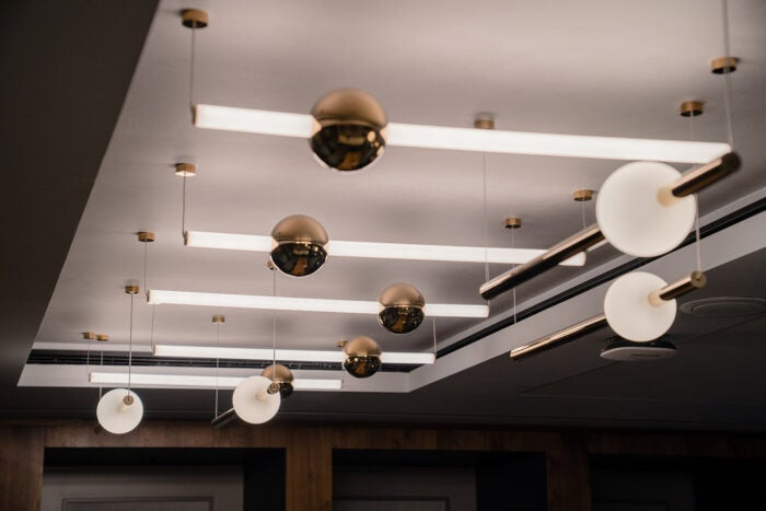 Lights designed by Tom Dixon and Lee Broom at Centurion Lounge London Heathrow Airport